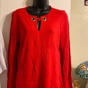 Red long sleeve blouse, with a gold key hole